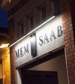 Close up of Mem Saab logo on outside of building